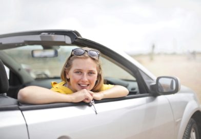Person happy after buying new used car