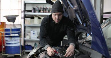 Person servicing a car