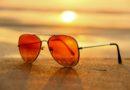 Summer sunglasses on a sunset