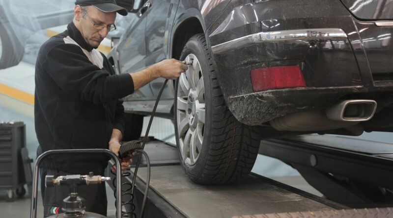 Person performing car inspection to save customer money