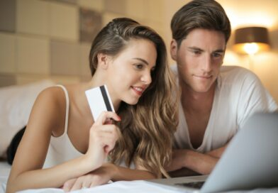 Couple shopping online for cars