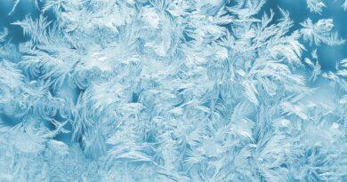 Cool ice on used car windscreen